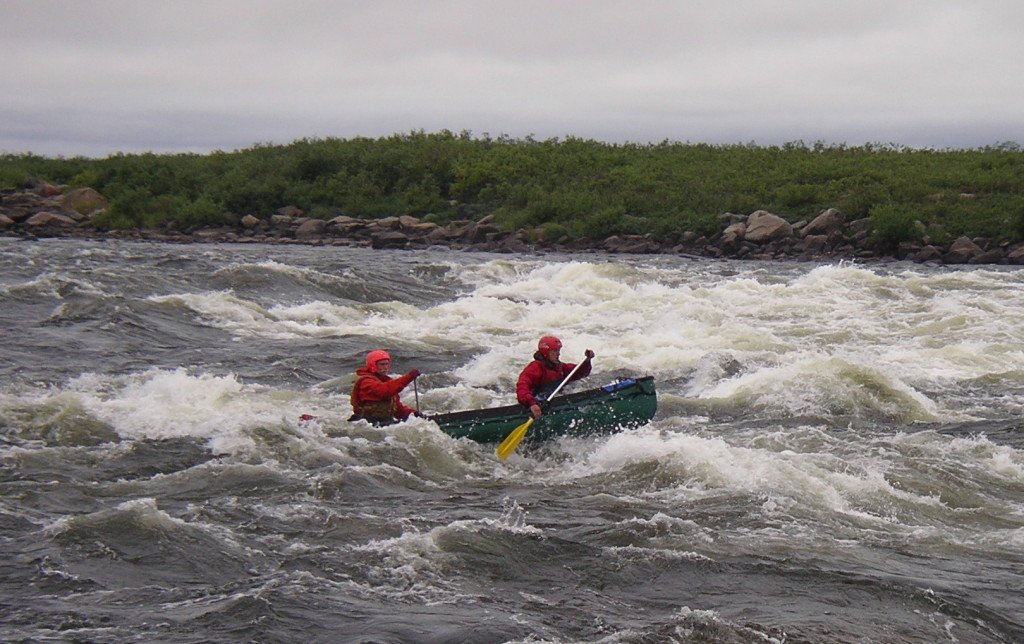 Clark and Peter Agre canoeing in Deaf Rapids